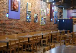 Plaid Turnip - Brick Wall With Artwork and Seating